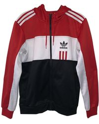 adidas Giacca. Giubbotto in poliestere rosso