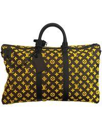 Louis Vuitton Bolsos en lona amarillo Keepall