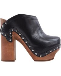 Roberto Cavalli Leather Mules & Clogs - Black