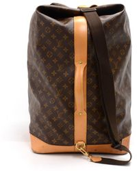 7650f6f842cd Lyst - Louis Vuitton Pre-owned Keepall Cloth Travel Bag in Brown