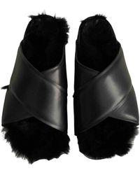 Celine Twist Leather Mules - Black