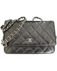 Chanel Bolsa clutch en cuero negro Wallet on Chain
