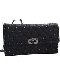 Valentino Bolsa clutch en cuero negro Rockstud spike