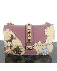 Valentino Bolsa de mano en cuero multicolor Rockstud - Rosa