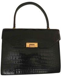 fbc24f8f4b Hermès - Pre-owned Vintage Piano Black Crocodile Handbags - Lyst