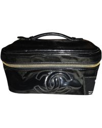 b3512d188 Chanel Pre-owned Patent Leather Clutch Bag in Black - Lyst
