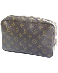 Louis Vuitton Sac de voyage Trousse de Toilette en Toile Marron - Multicolore