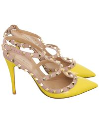 53d6b223ec Valentino - Pre-owned Rockstud Yellow Patent Leather Heels - Lyst