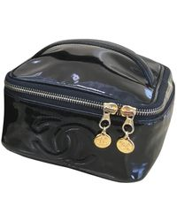 Chanel - \n Black Patent Leather Travel Bag - Lyst
