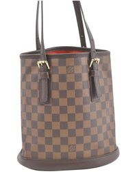 7e58c1005812 Lyst - Louis Vuitton Pre-owned Bucket Cloth Tote in Brown