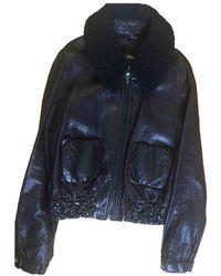 Chanel Giacca in pelle in pelliccia nero