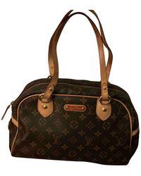 Louis Vuitton Montorgueil Leinen Handtaschen - Braun