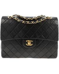Chanel Bolsa de mano en cuero negro Timeless/Classique