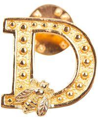Dior Broche en metal dorado - Metálico
