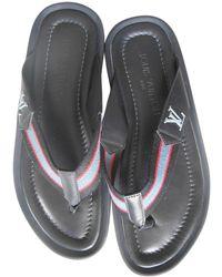 Louis Vuitton Sandalias en caucho negro