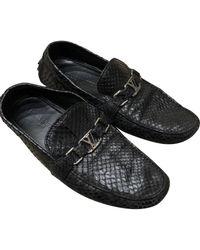 Louis Vuitton Mocasines en cocodrilo negro