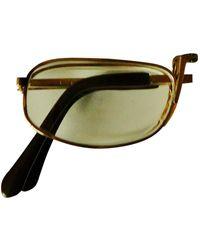 Dior Occhiali in metallo dorato - Metallizzato