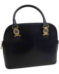 fdc476432c Lyst - Versace Vintage Gold Python Handbag in Metallic