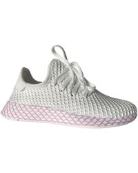 adidas Sneakers Deerupt Runner in Tela - Bianco
