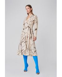 Victoria Beckham Long Sleeve V-neck Flare Midi Dress In Khaki - Natural