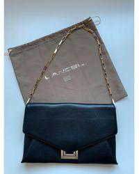 Lancel - Sac pochette en cuir cuir noir - Lyst