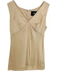 Dolce & Gabbana - Top, tee-shirt soie doré - Lyst