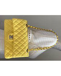 Chanel Sac à main en tissu toile Timeless - Classique jaune