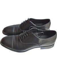 Versace Chaussures à lacets cuir noir