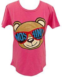 Moschino - Top, tee-shirt coton rose - Lyst