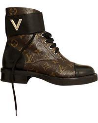 Louis Vuitton Bottines & low boots plates cuir marron