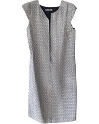 Jil Sander - Robe mi-longue laine noir - Lyst