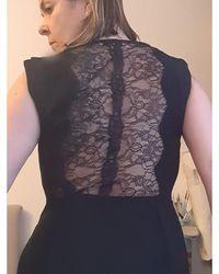 Sandro - Robe courte polyester noir - Lyst