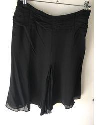 Karen Millen - Jupe mi-longue soie noir - Lyst