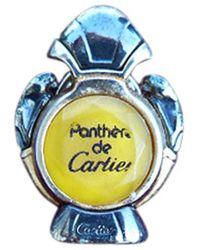 Cartier Pin's métal jaune - Bleu