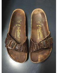 Birkenstock Sandales plates cuir marron