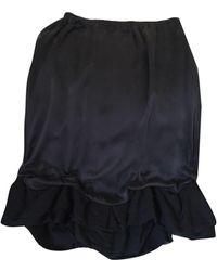 Maje - Jupe mi-longue soie noir - Lyst