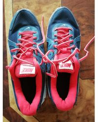Nike - Baskets toile rouge - Lyst