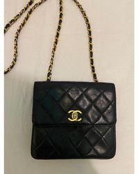 Chanel Sac en bandoulière en cuir cuir noir