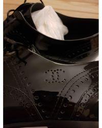 Chanel Chaussures à lacets cuir verni noir