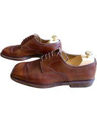 Louis Vuitton Chaussures à lacets cuir marron