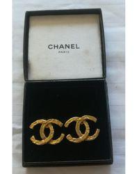 Chanel Boucles d'oreilles acier doré - Métallisé