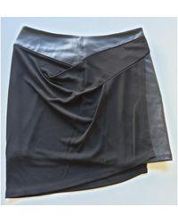 The Kooples Jupe courte polyester avec empiecement cuir noir