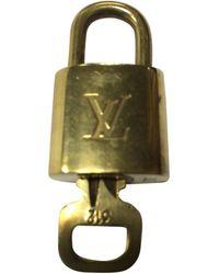 Louis Vuitton Bijou de téléphone laiton doré - Métallisé