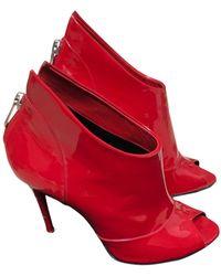 Balmain Bottines & low boots à talons cuir verni rouge