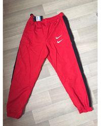 Nike - Pantalon de survêtement nylon rouge - Lyst