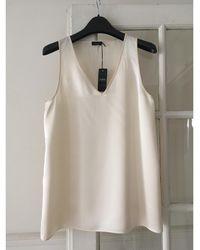 JOSEPH - Top, tee-shirt soie blanc - Lyst