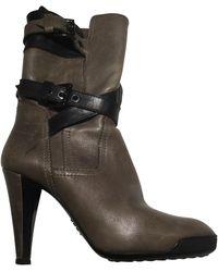 Tod's - Bottines & low boots à talons cuir gris - Lyst