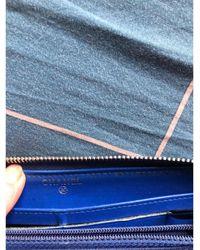 Chanel Portefeuille cuir verni bleu