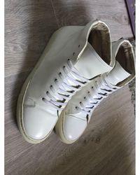 Sandro Baskets cuir verni blanc