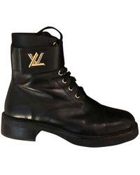 Louis Vuitton Bottines & low boots plates cuir noir